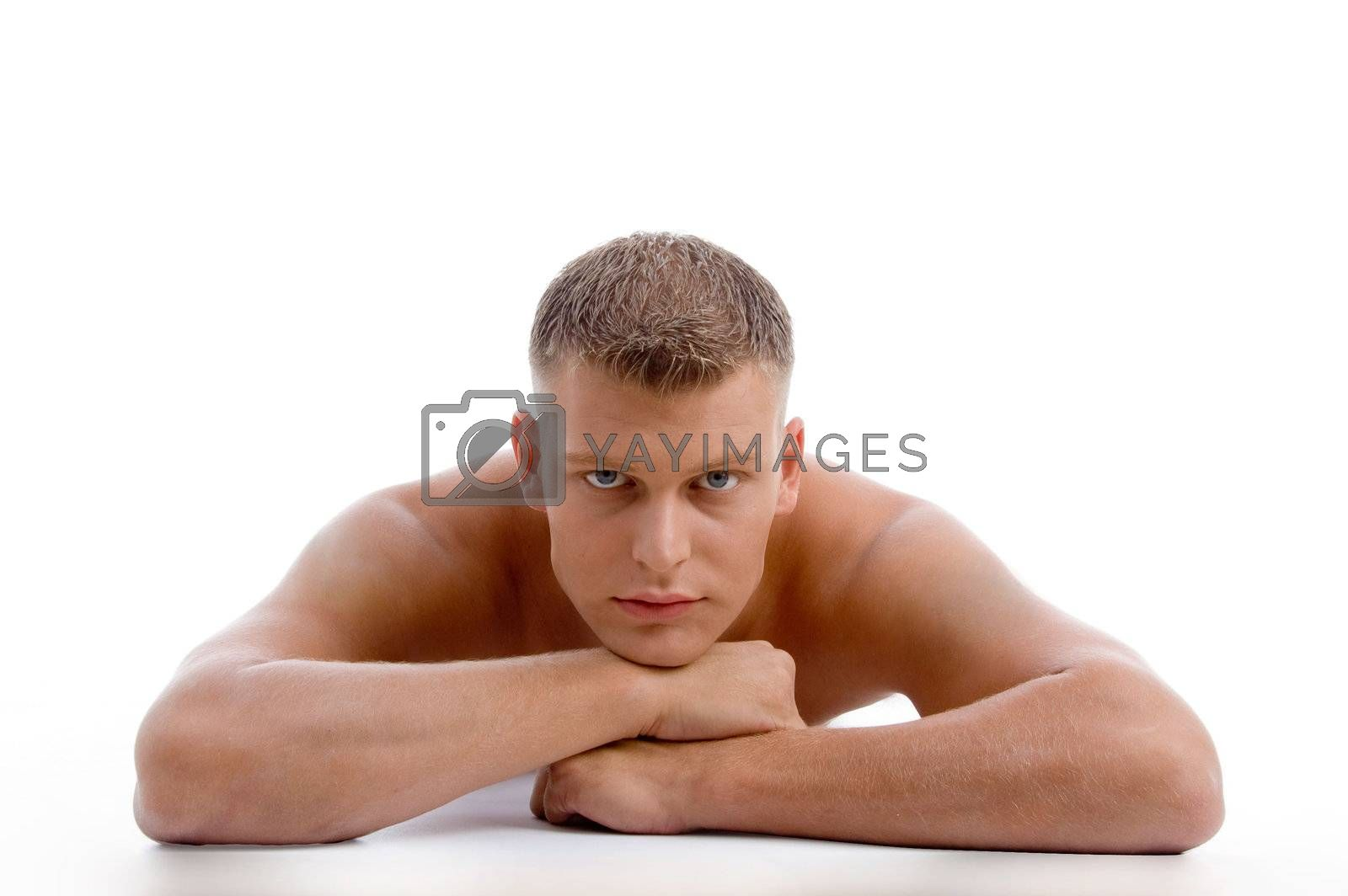 laying muscular male looking at you on an isolated white background