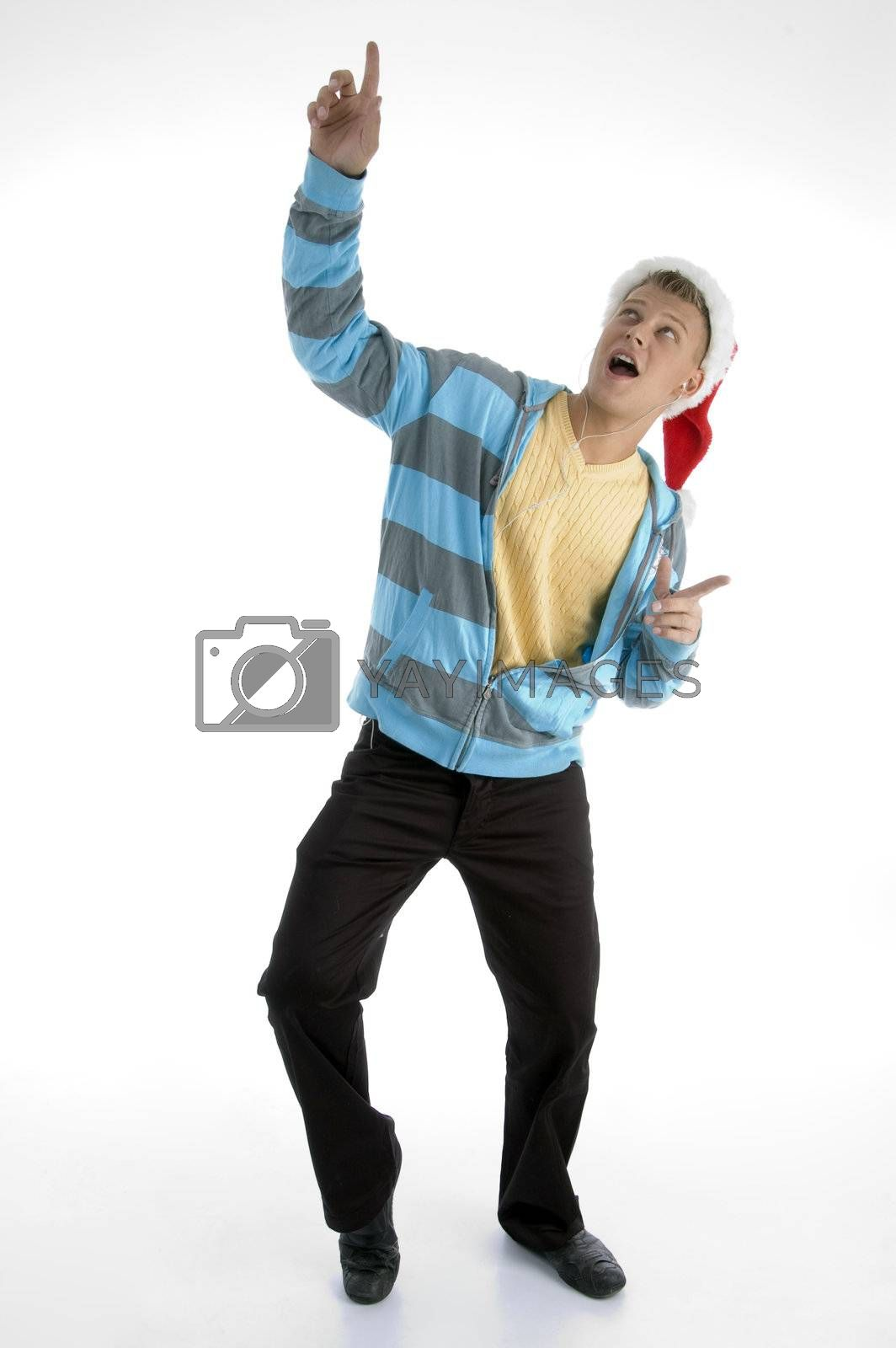 pointing man with christmas hat against white background
