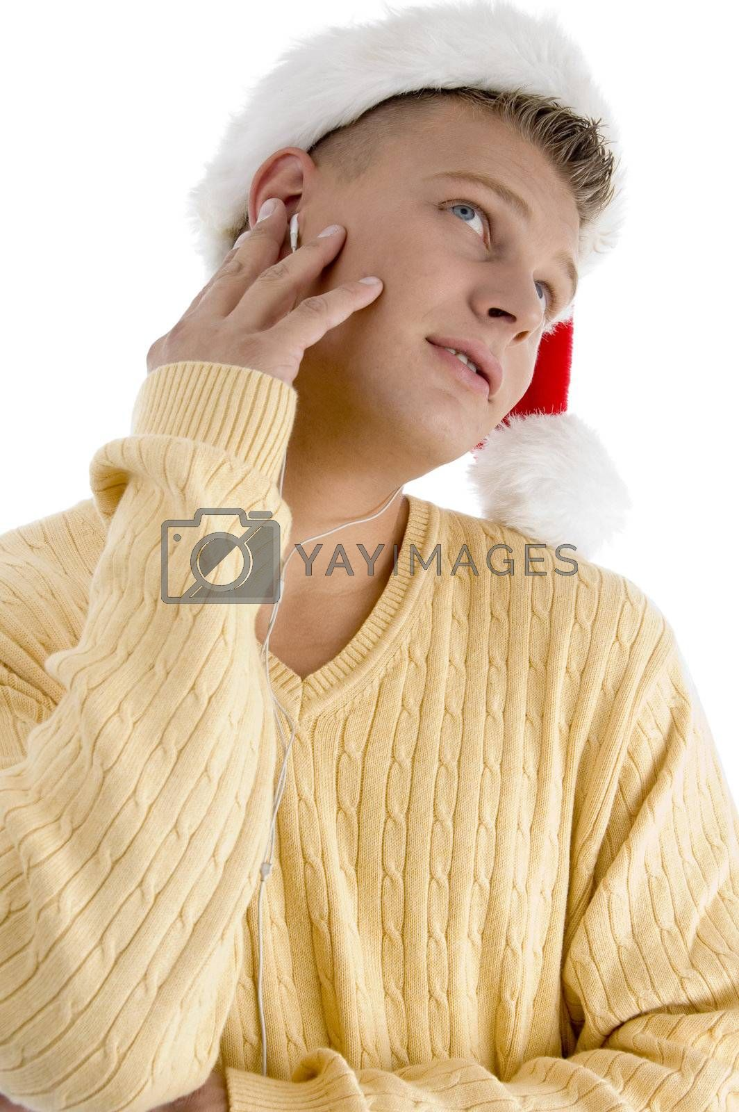 male with christmas hat and looking upward  on an isolated white background