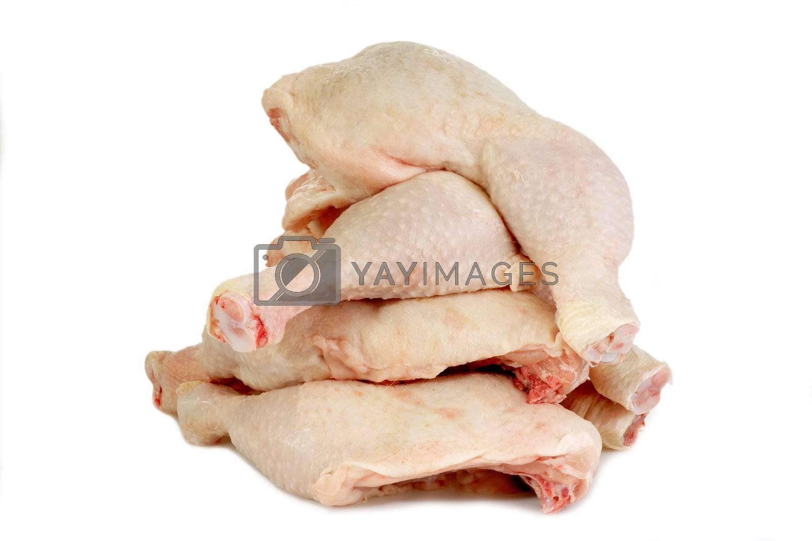 Raw chicken legs on bright background