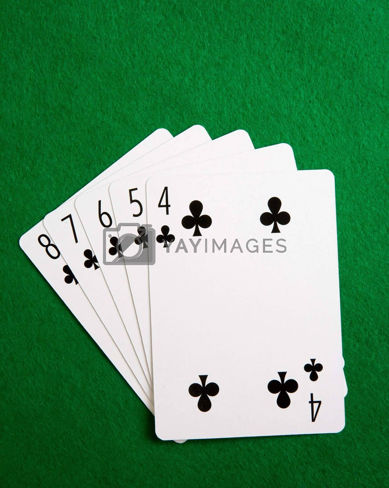 A straight flush in the suit of clubs