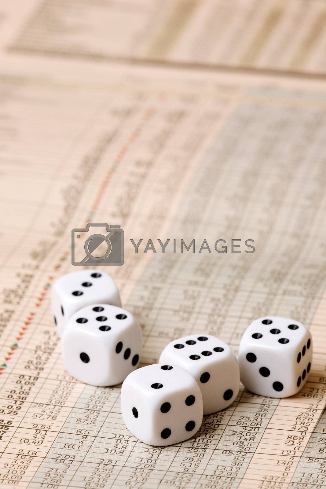 Dice sitting on a stock market chart
