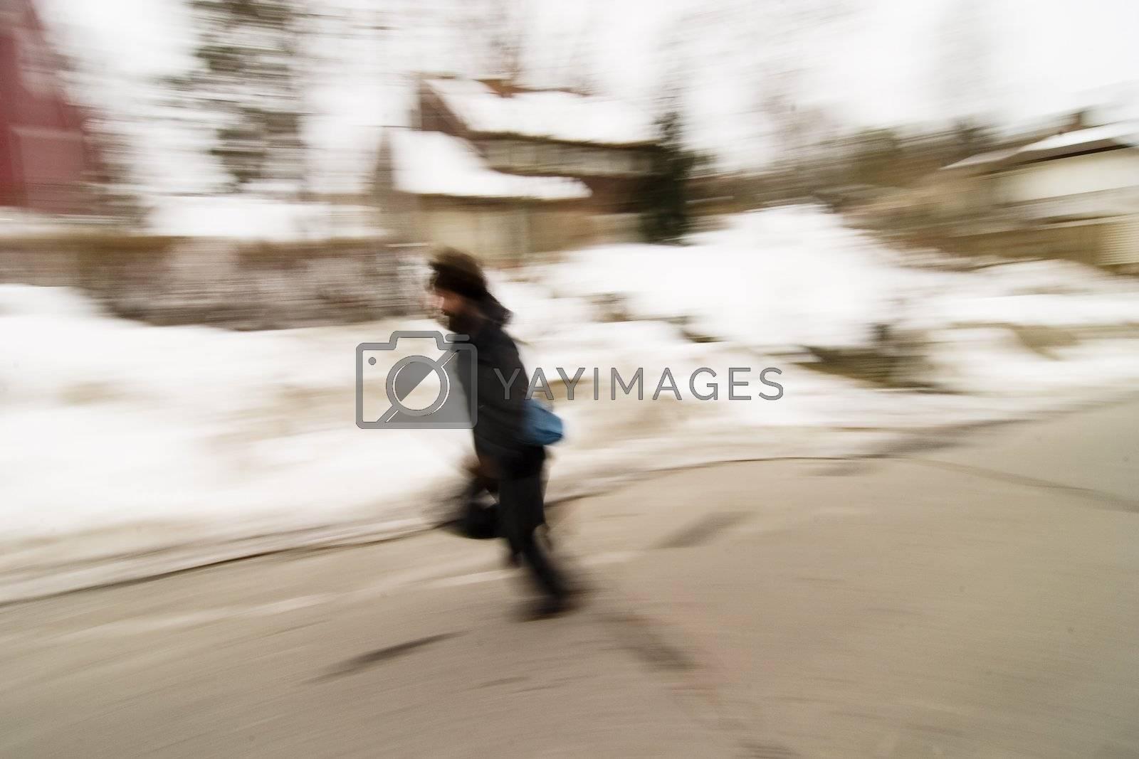 A motion blur image of a man running.