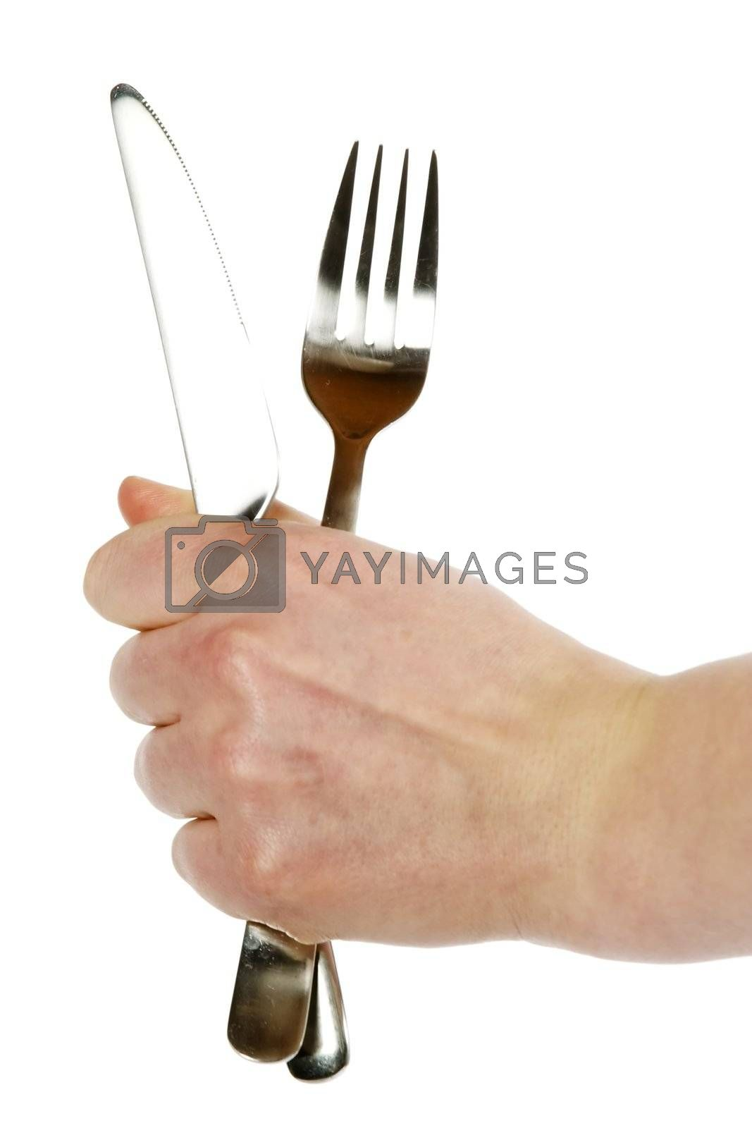 A knife and fork being held by a womans hand.  Isolated on white with clipping path.
