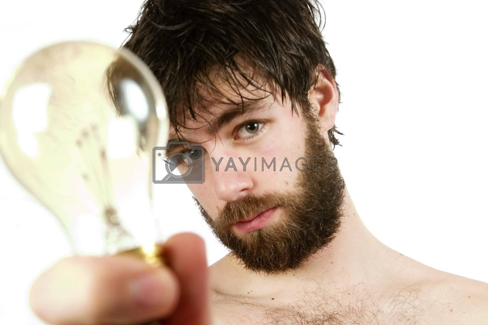A humor shot, of a young newly showered male, holding a light bulb, thinking up fresh new ideas.