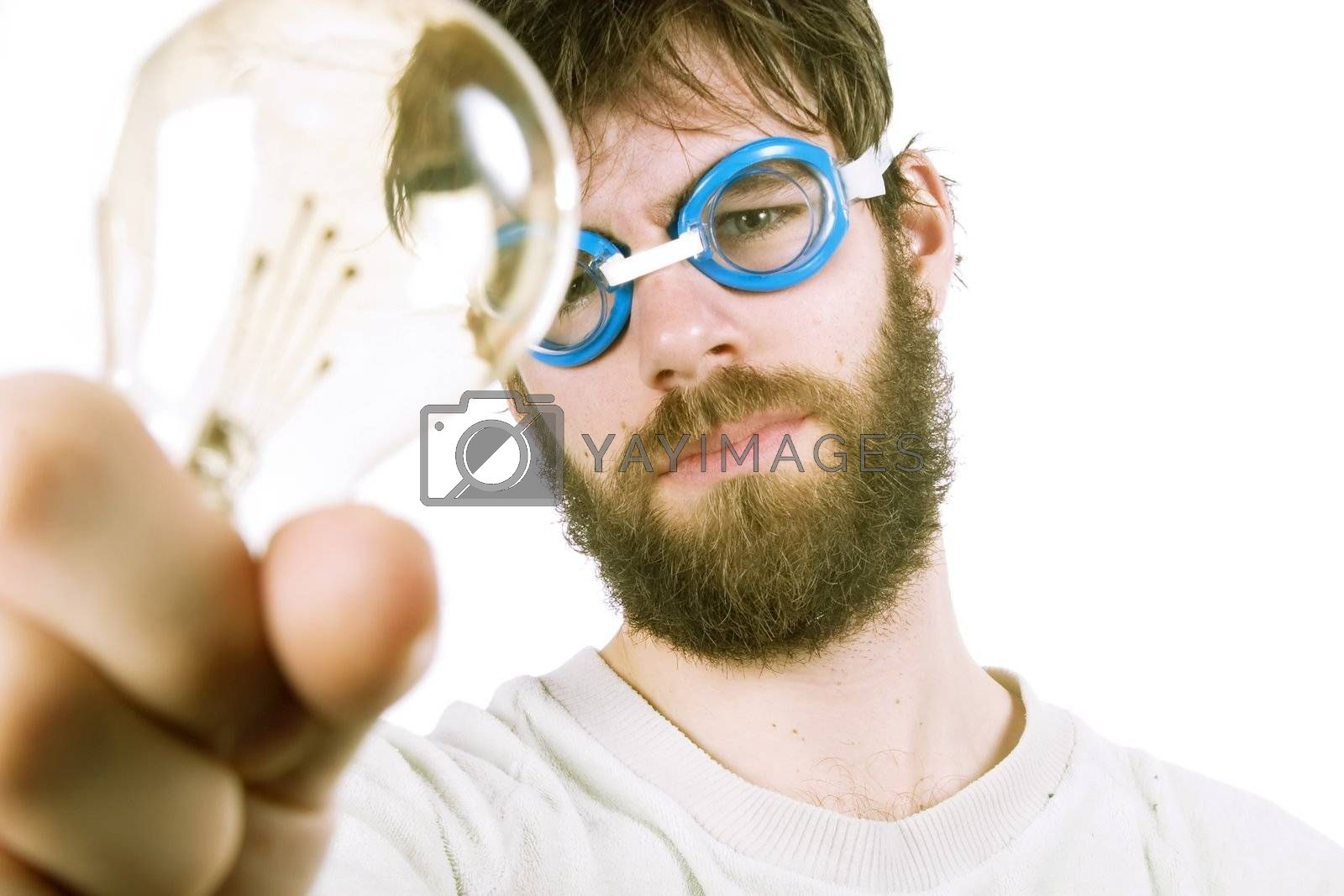 A concept image protraying a funny / good idea.  A young funny looking bearded male with swimming goggles holding up a light bulb.