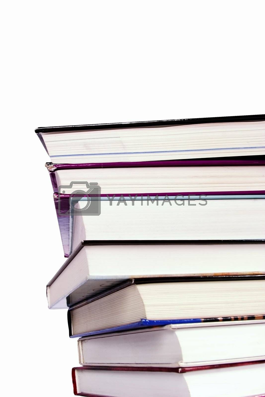 An endless stack of hard cover text books piled high, isolated on white.  Vantage point from below.