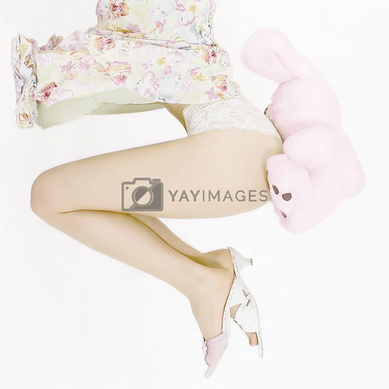 Woman legs and plush rabbit