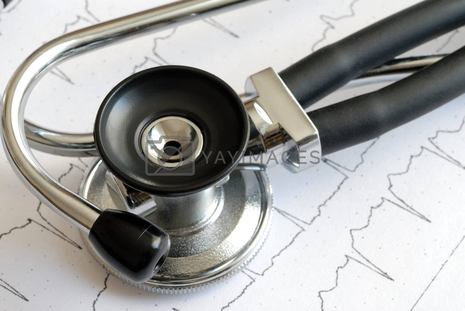 Macro of stethoscope lying on ECG diagram
