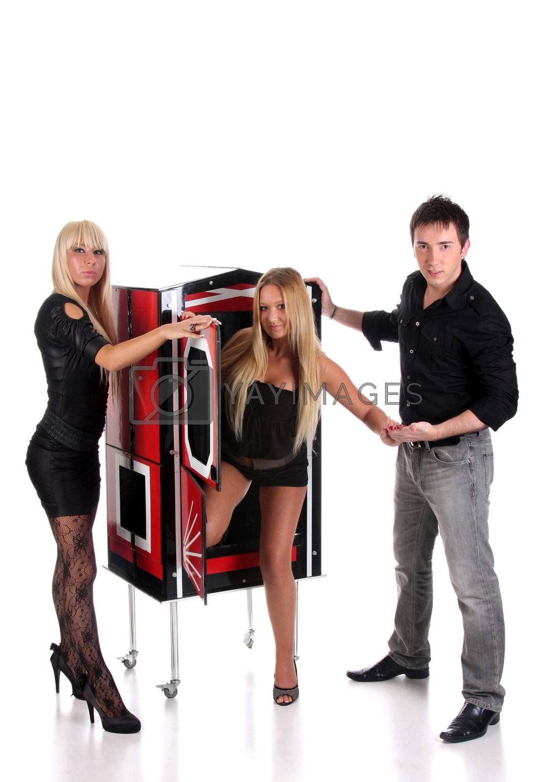 Magician performance with beauty girls in a magic box