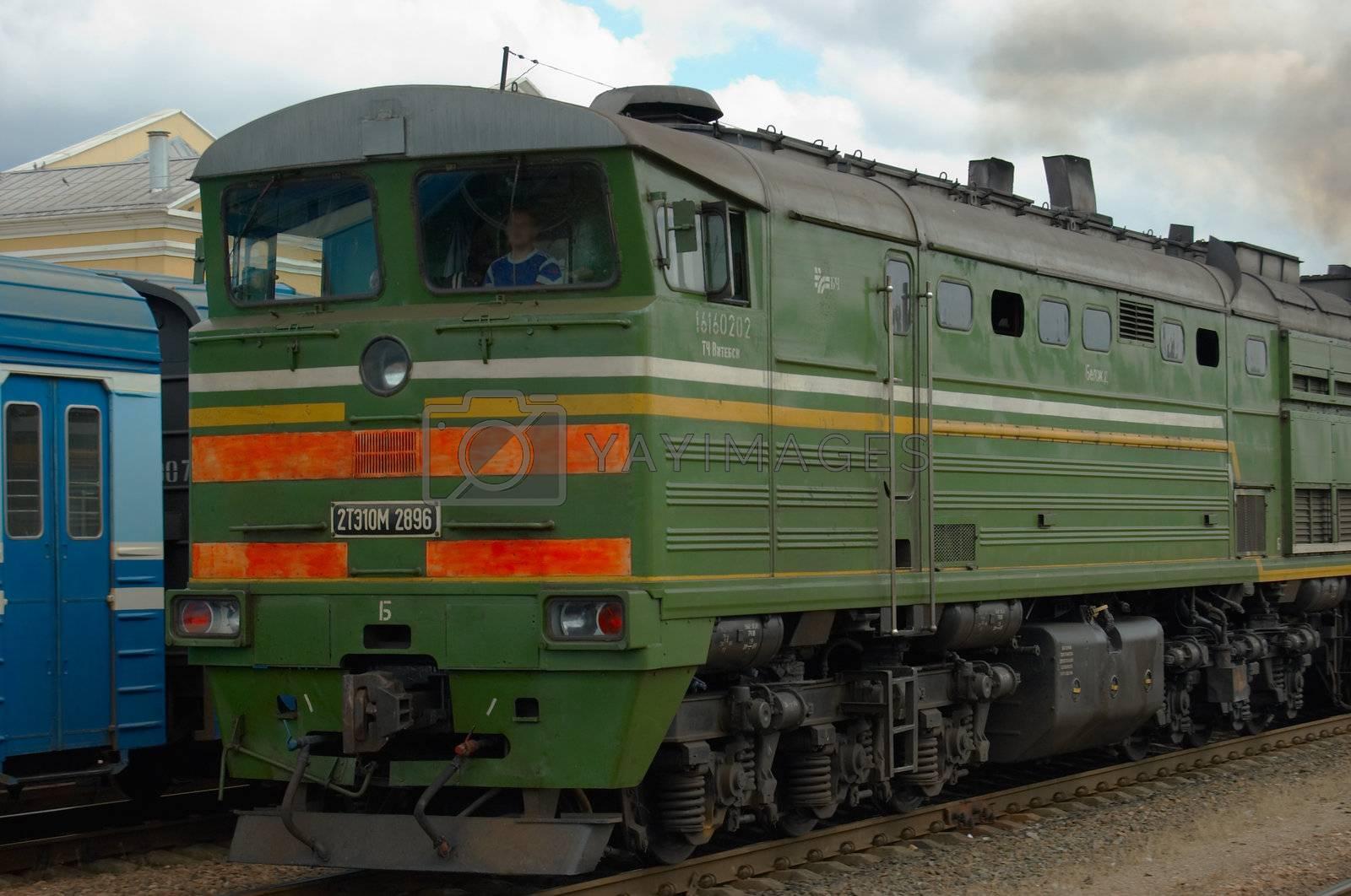 The cargo disel locomotive drives a heavy train