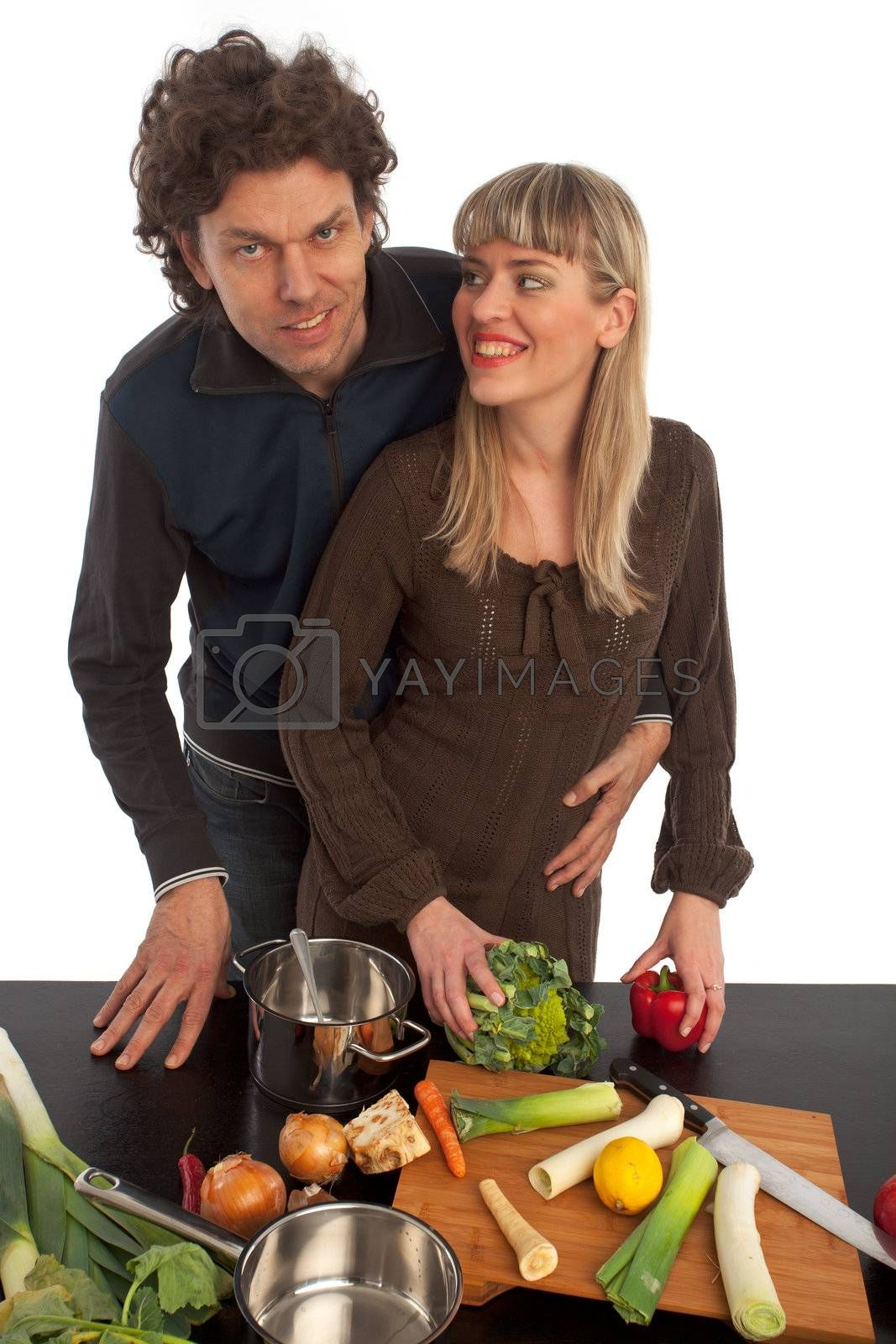happy couple cooking insolated on white