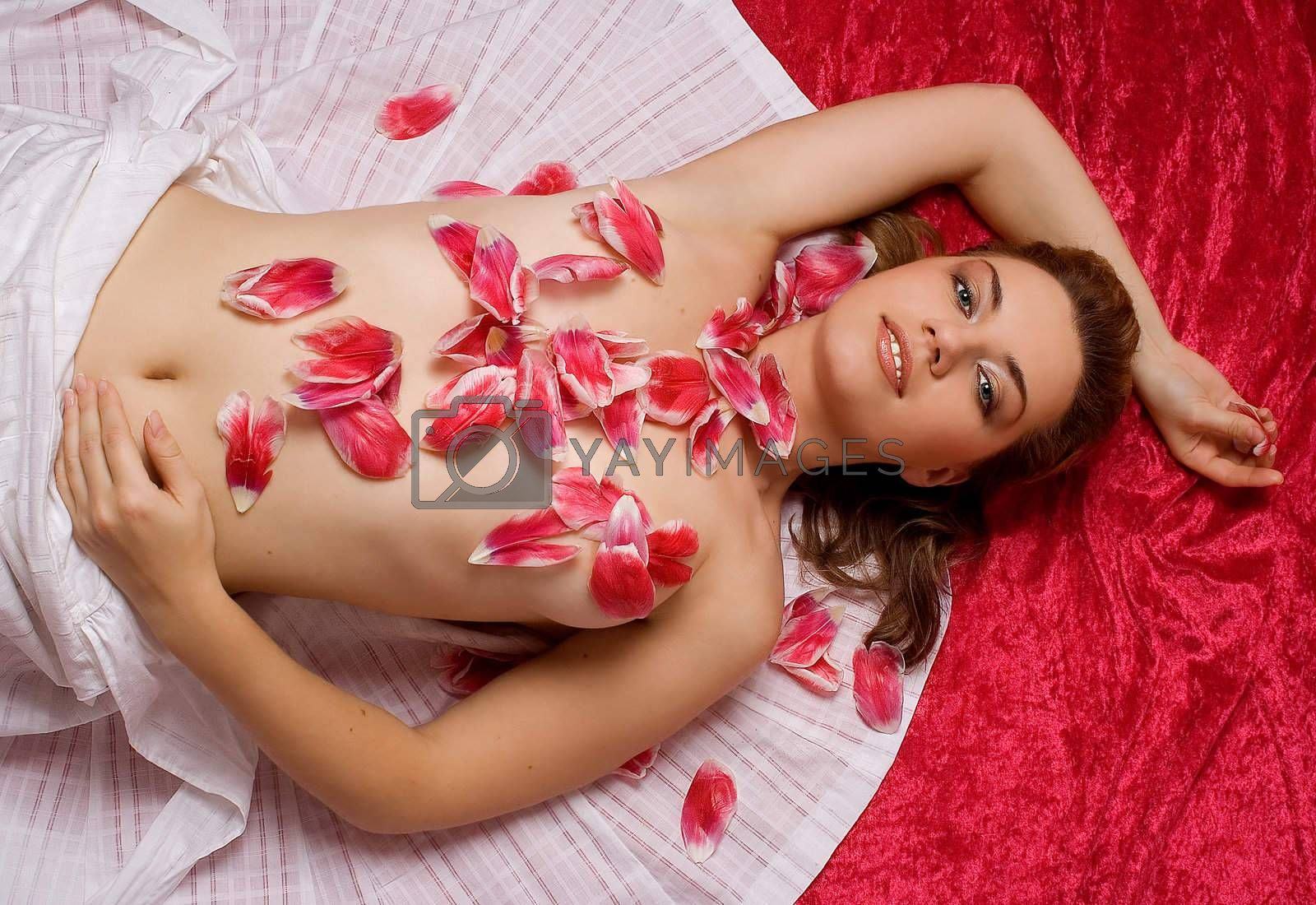 Woman covered with tulip petals