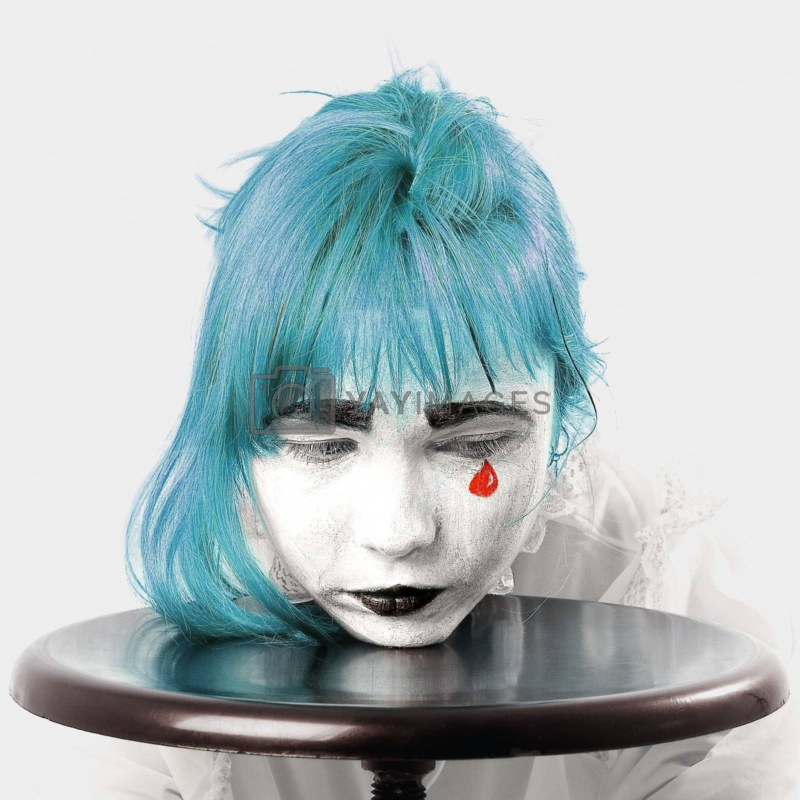 clown makeup girl with blue hair and red tear