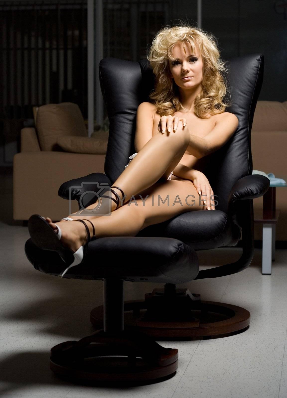 naked girl in black chair