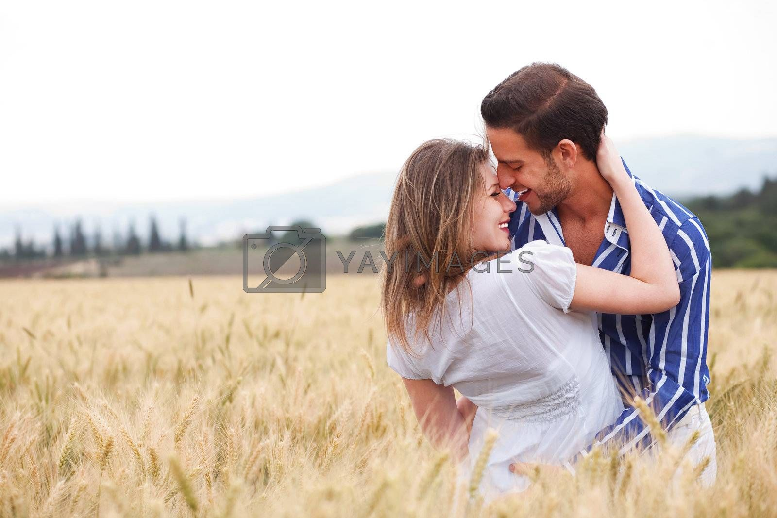 young Couple smiling eachotherr in the meadow