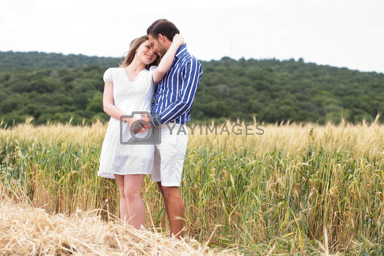 Young couple in love standing in the pathway