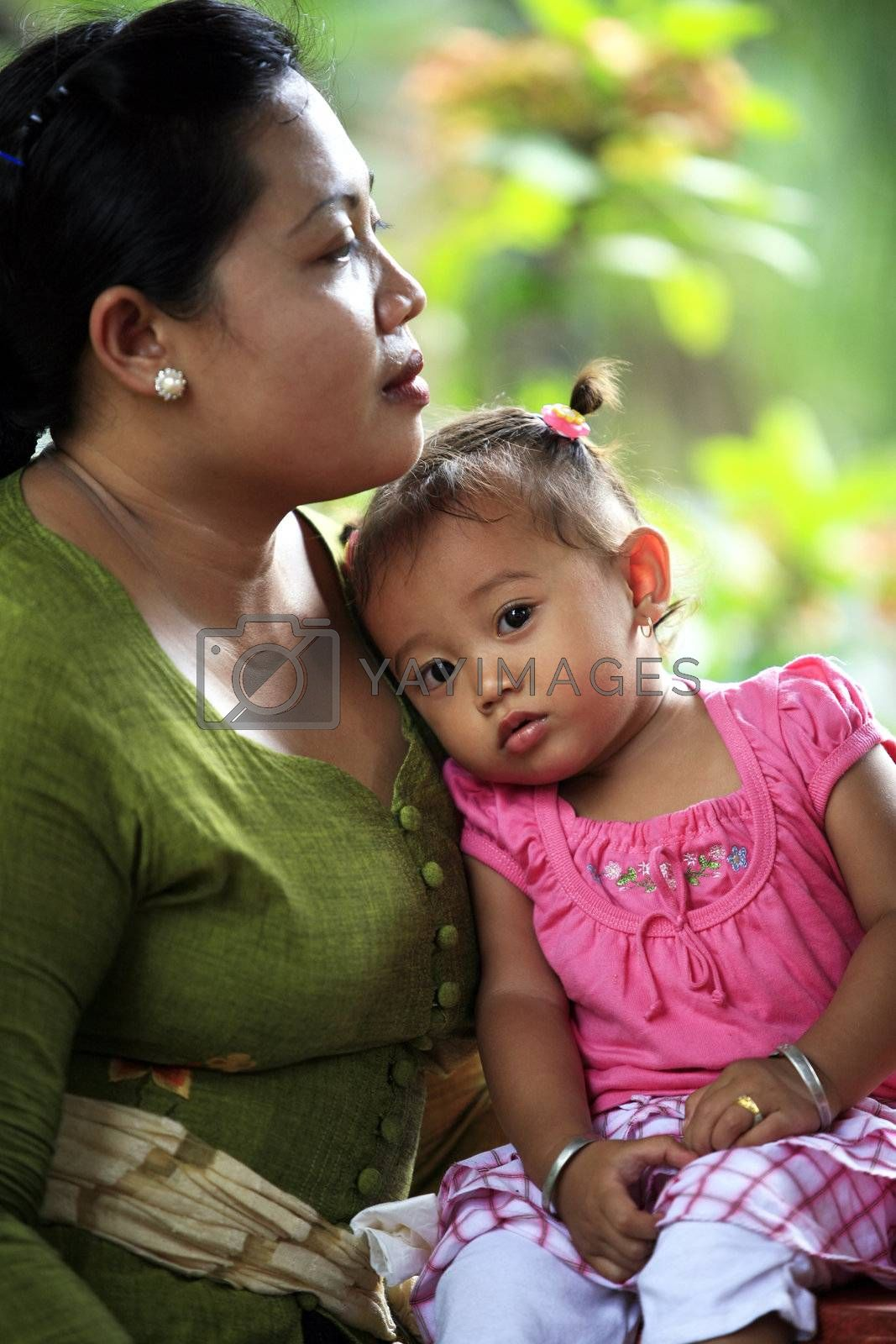BALI, INDONESIA - OCTOBER 31: Mother with baby. October 14 in Bali, Indonesia