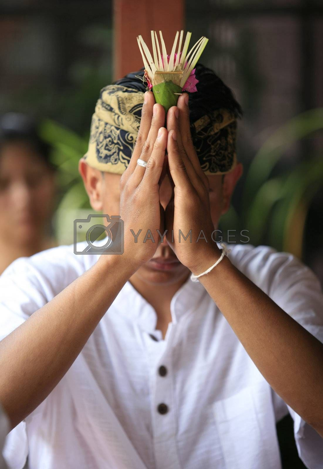 The Indonesian groom prays. Bali. Indonesia