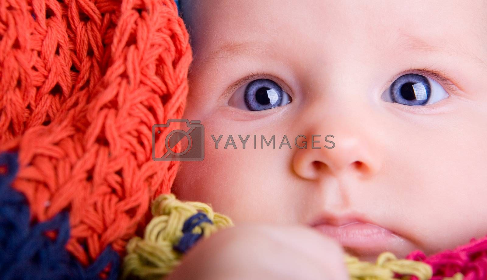 Portrait of three month old baby girl with big blue eyes