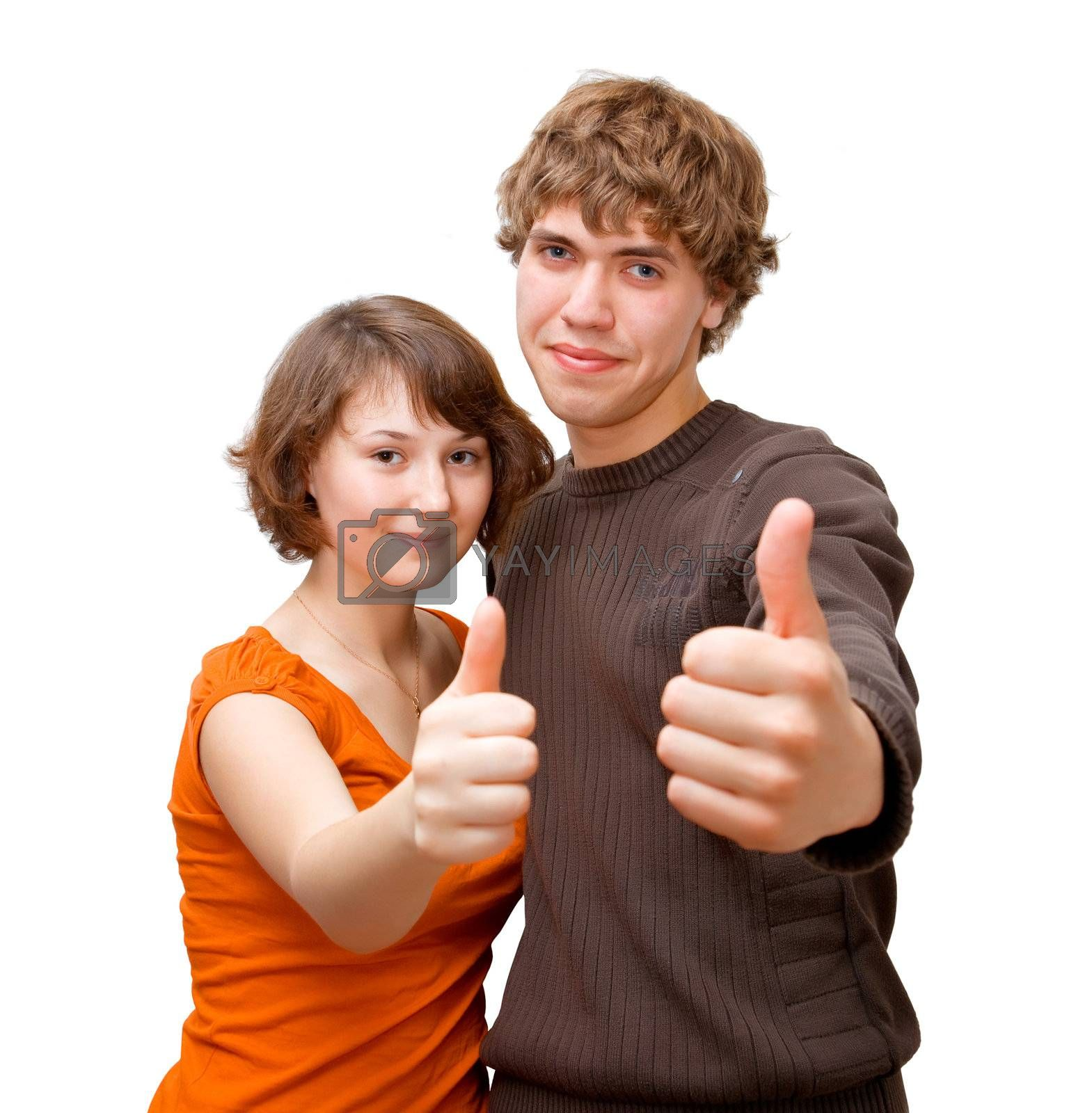 Young couple holding their thumbs up