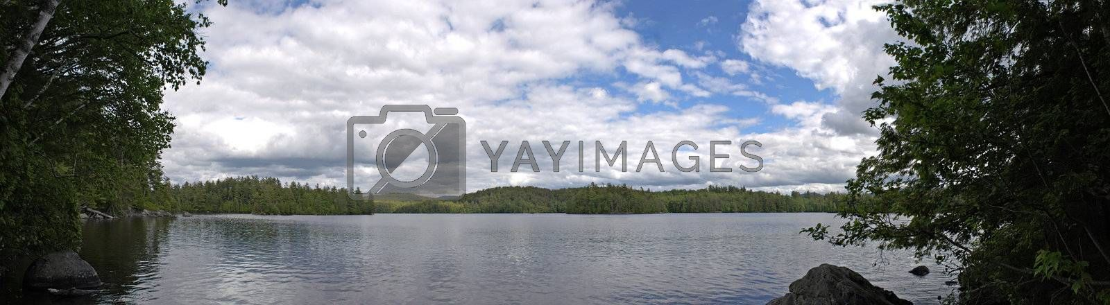 A wide angle panoramic view of the lower Saranac Lake and islands located in the upstate New York Adirondacks.