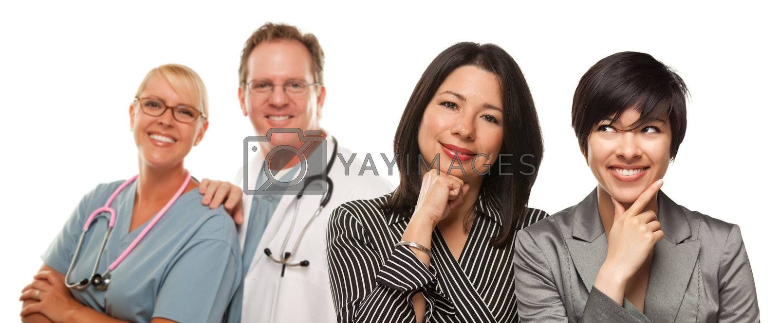 Attractive Hispanic Mother and Daughter with Doctor and Nurse Isolated on a White Background.