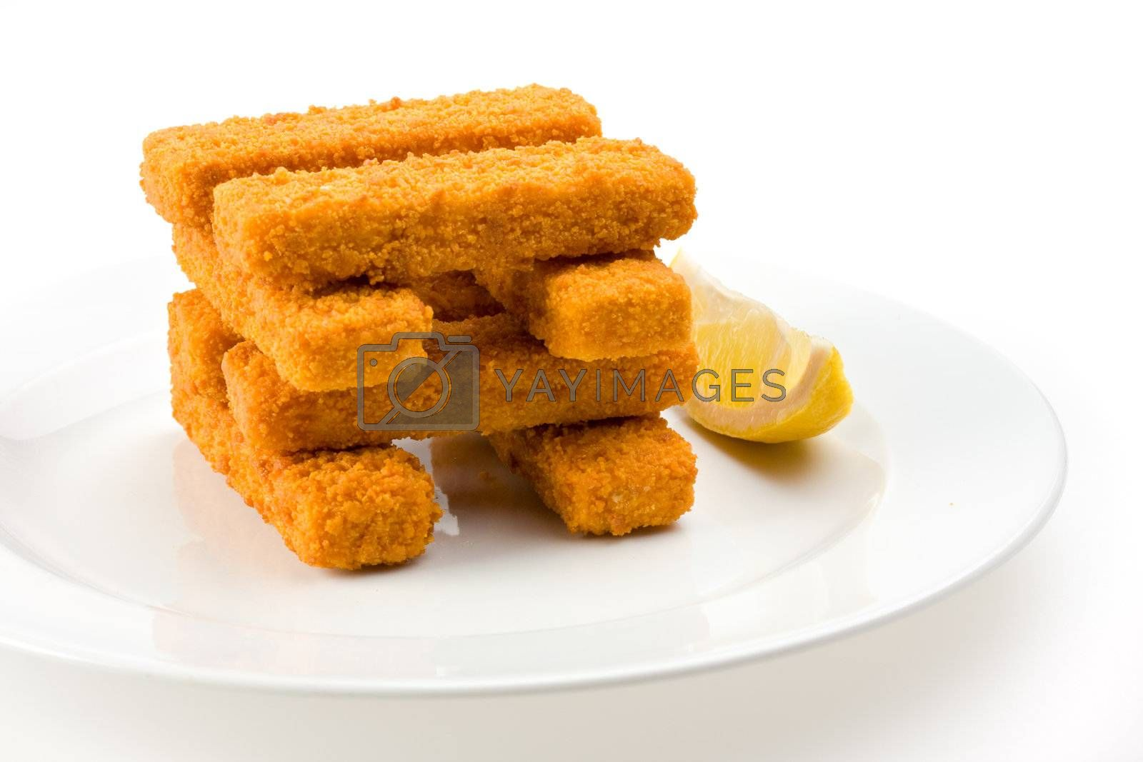 eight fish fingers on a white plate