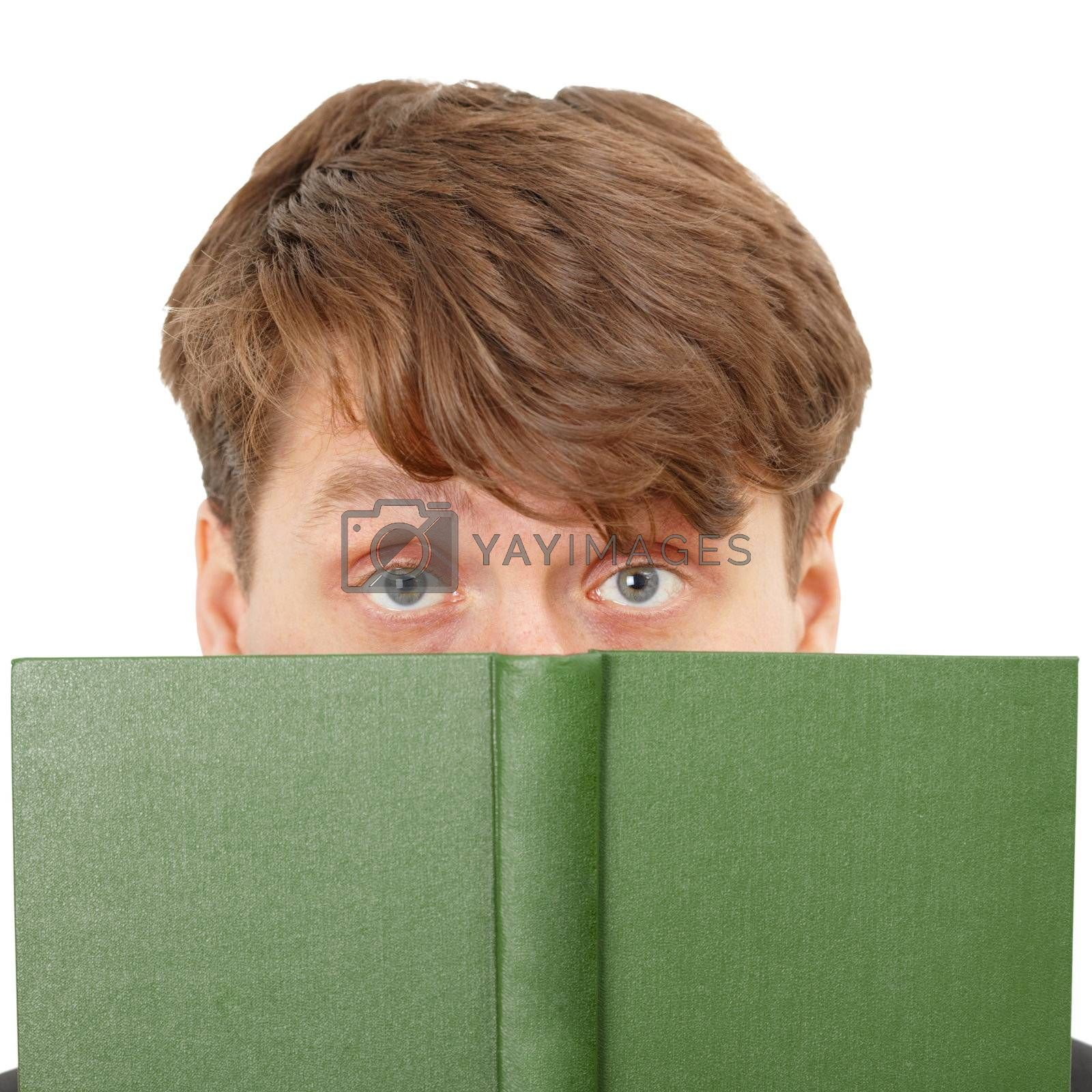 The young man hid his face behind a green book, close-up on a white background
