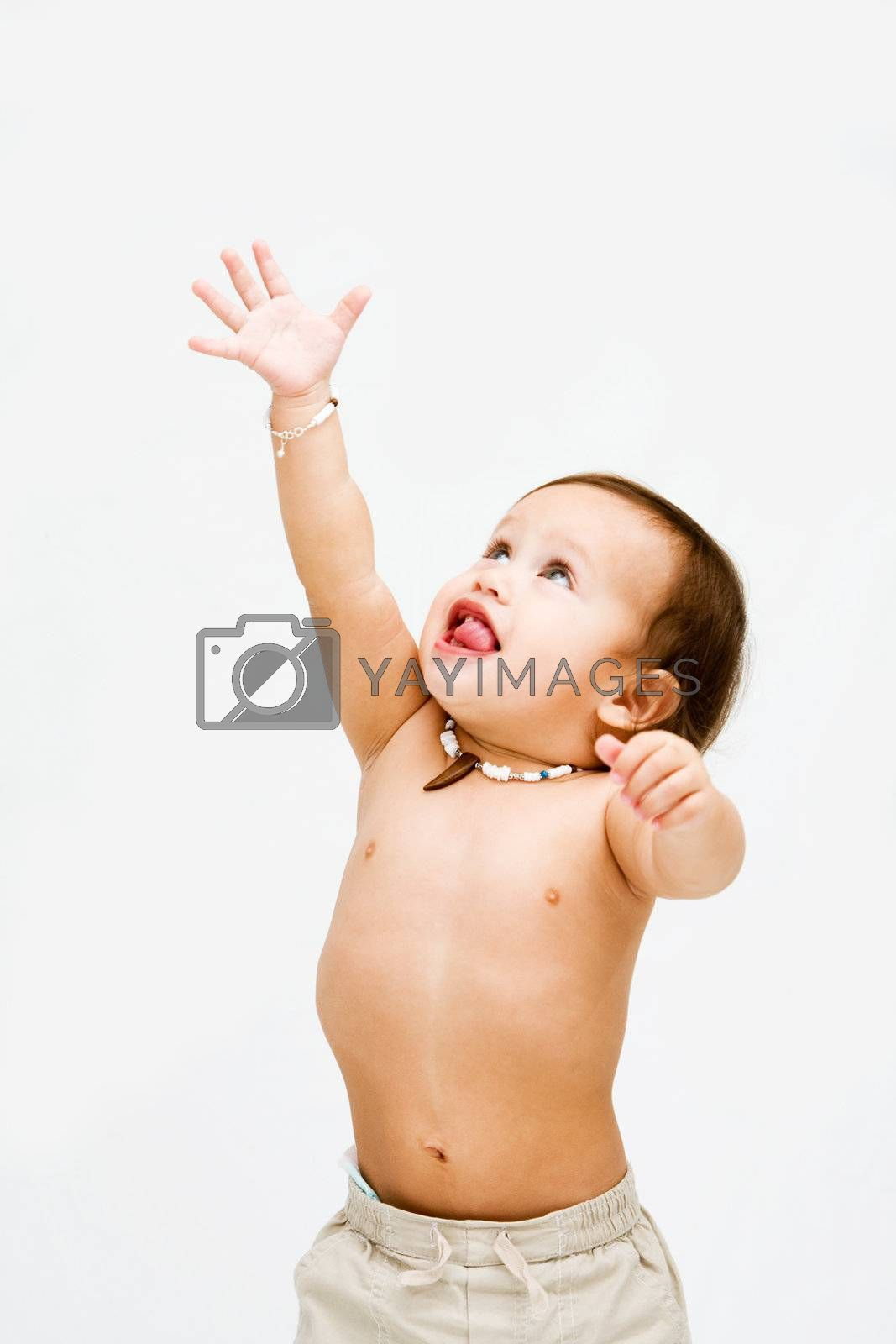 Cute topless toddler boy with necklace reaching for the sky, isolated