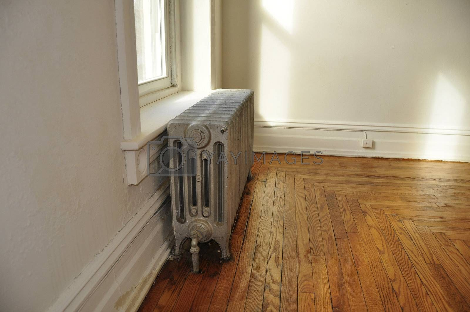 old radiator in an empty historic home