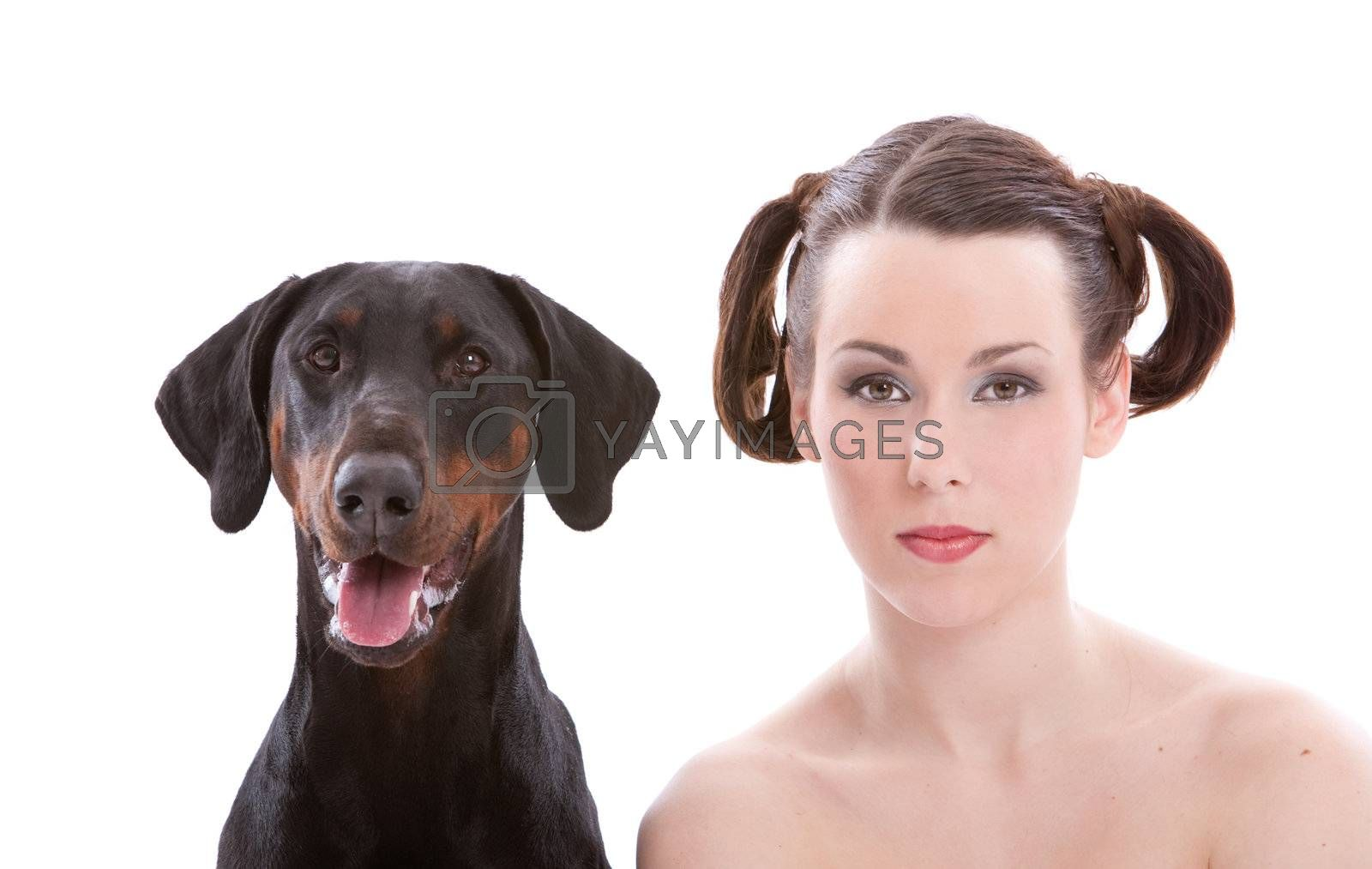Beautiful woman with a doberman pincher to her side