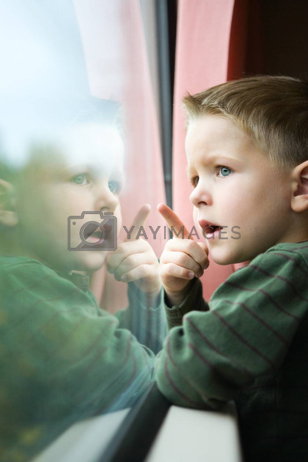 Cute 4-years old boy traveling by train