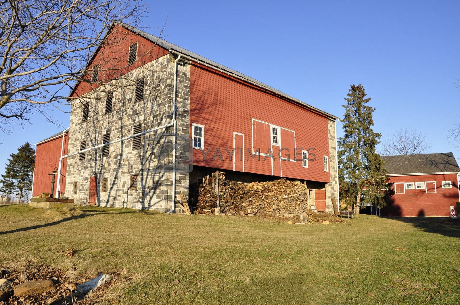 Royalty free image of red and stone barn by cfarmer