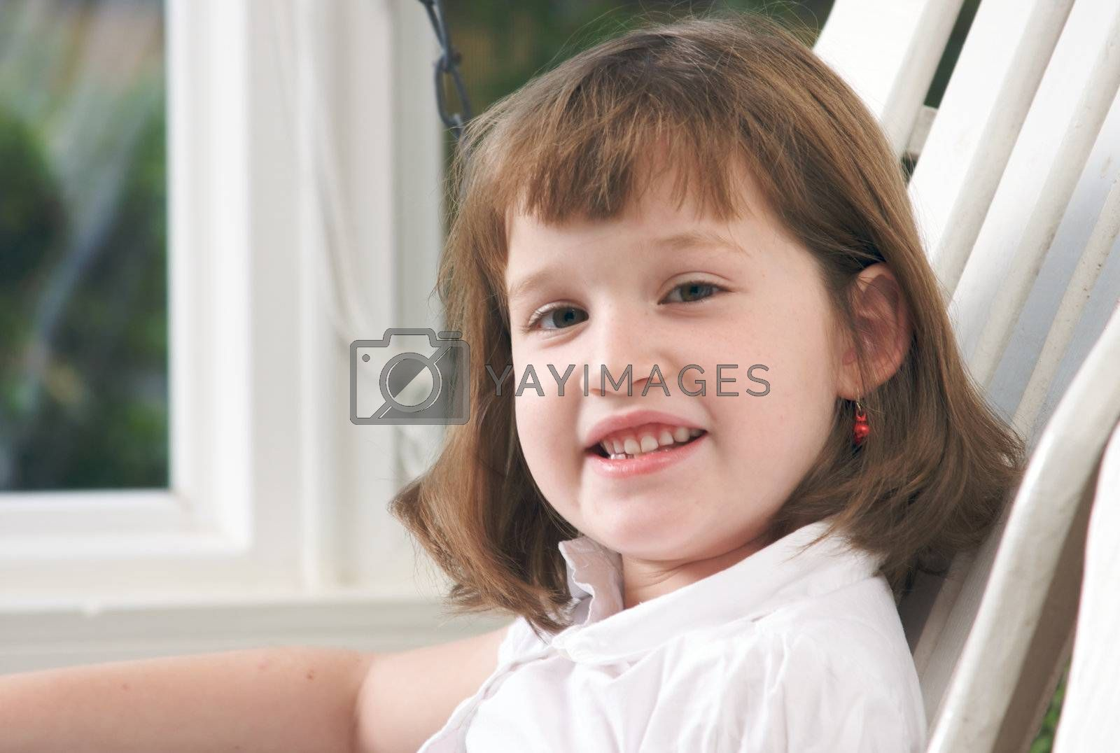 Adorable Girl Poses for a Fun Portrait