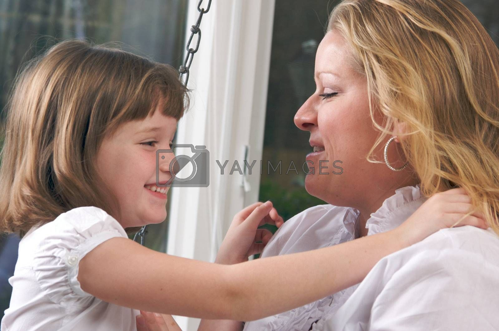 Young Mother and Daughter Enjoying a Personal Moment