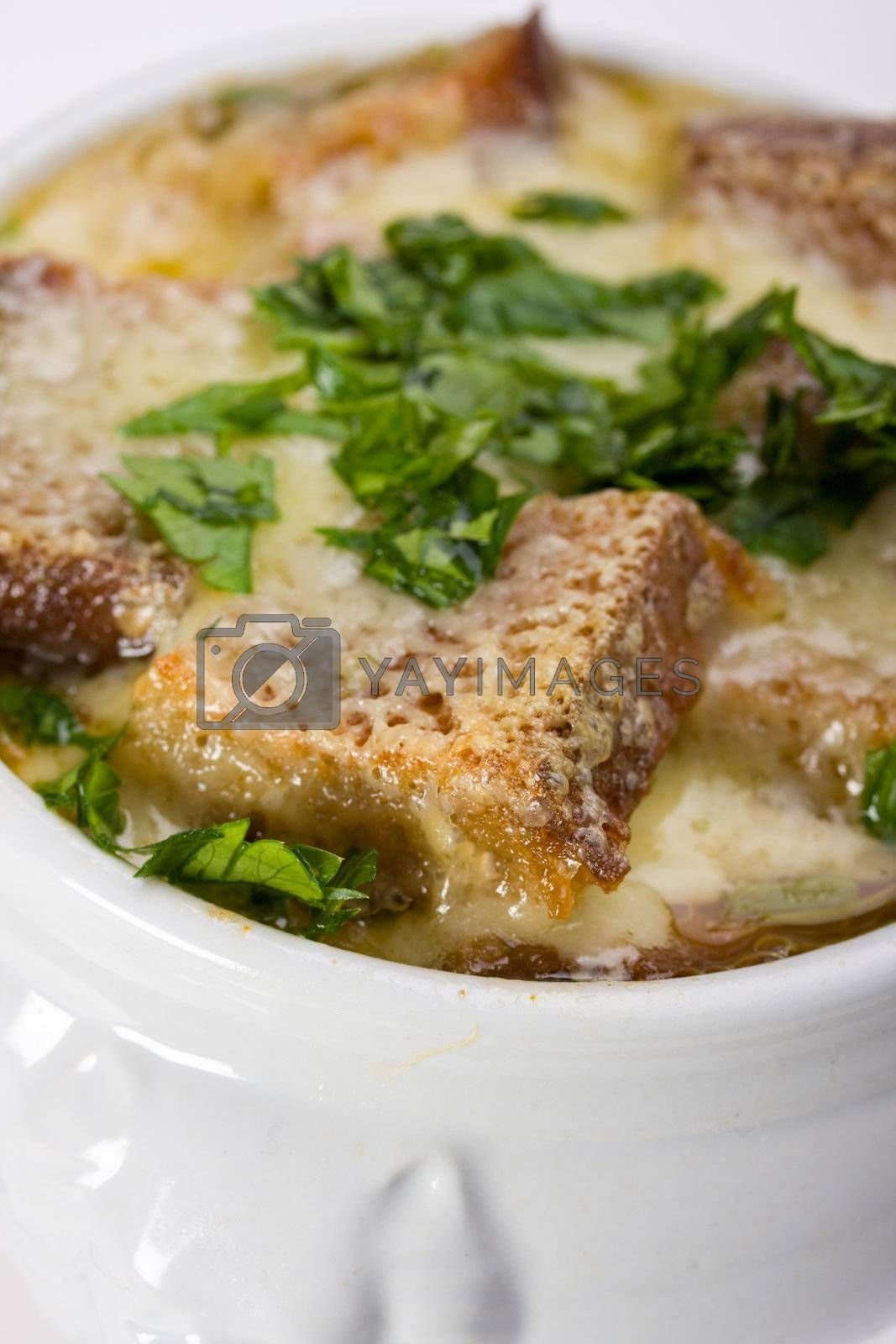 onion soup scalloped with cheese in a soup pot
