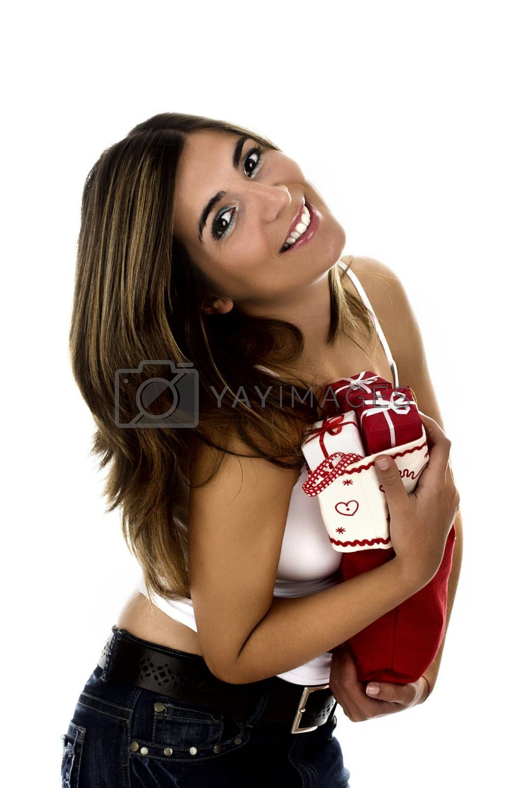 Christmas season! Different poses of a beautiful woman with small gifts on the hands.