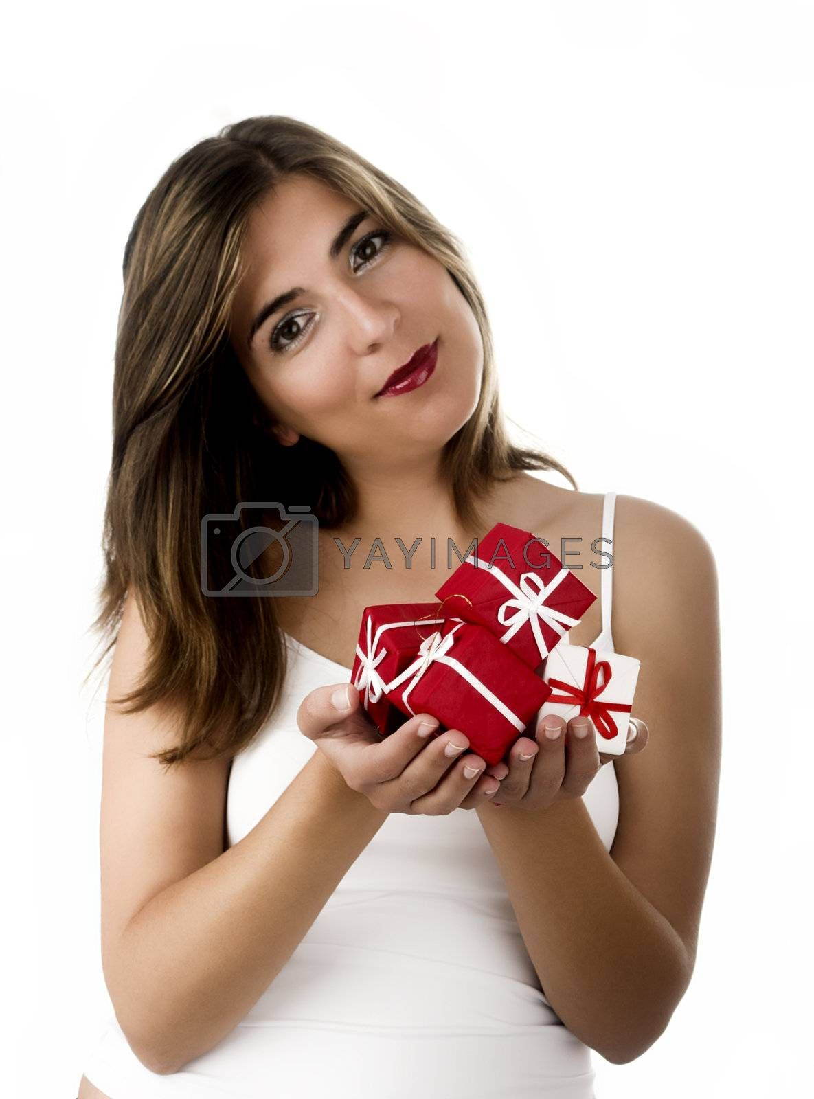 Christmas season! Different poses of a beautiful woman with small gifts on the hands.  (Focus is on the gifts)