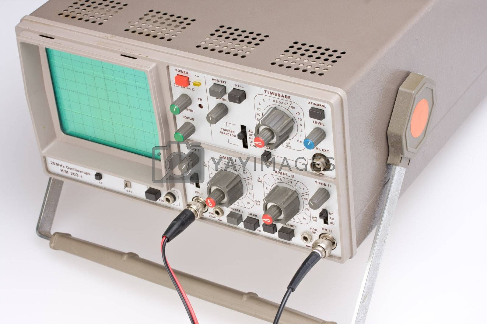 analogue oscilloscope on grey background