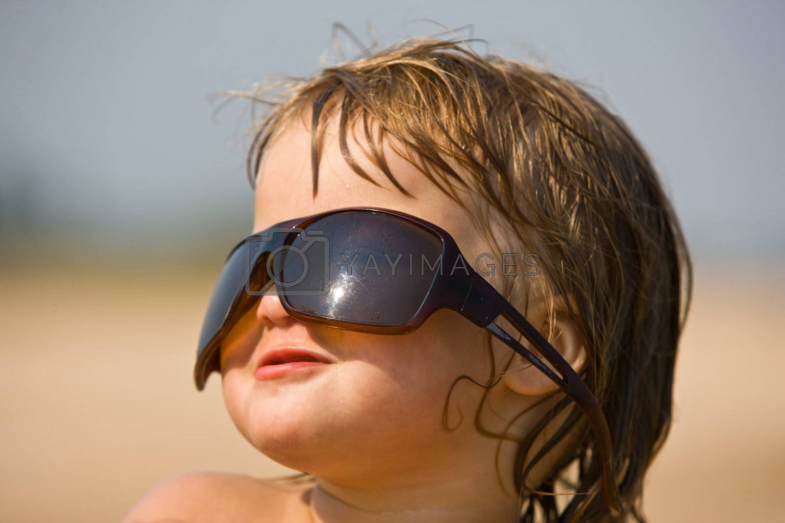little girl are play with the sun glasses