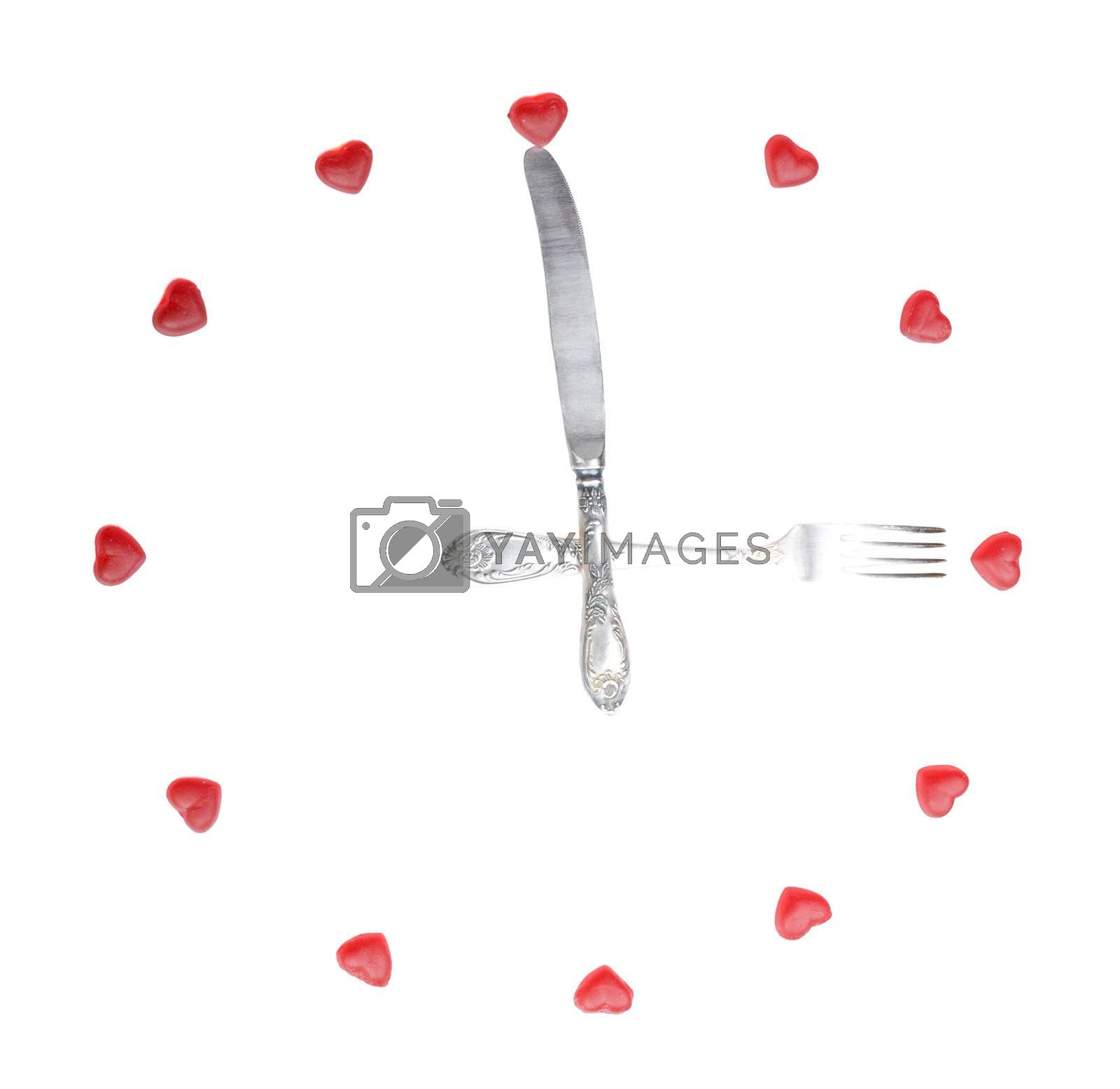 clock made from fruit jellies and dishware, show meal time, isolated on white