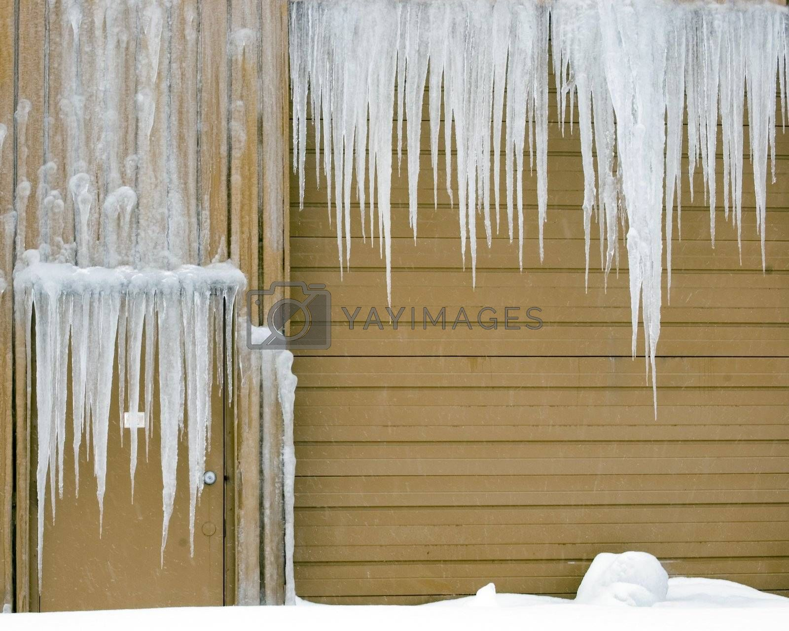 Icicles hanging down on a warehouse door and truck entrance.