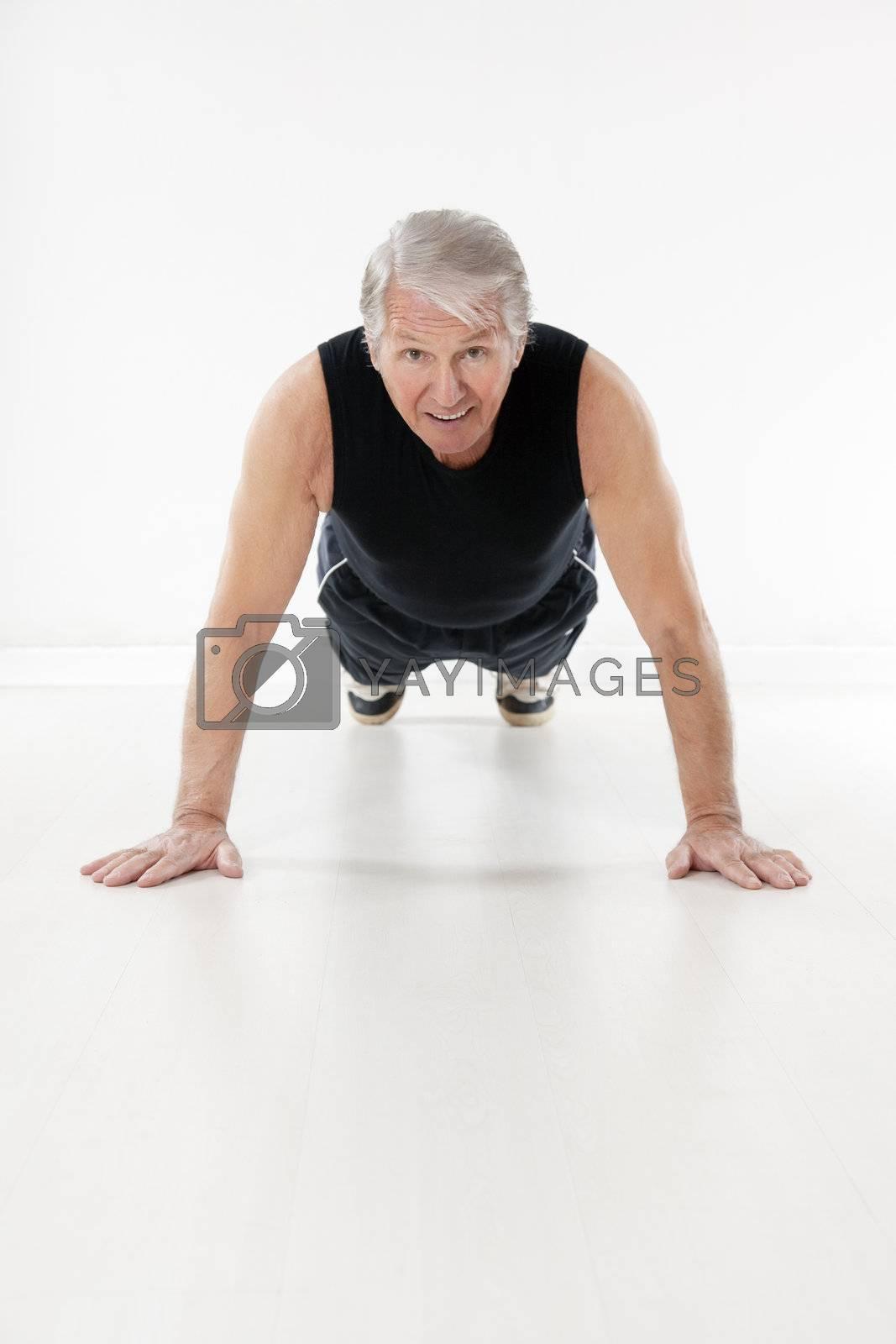 front view of senior man doing push-ups