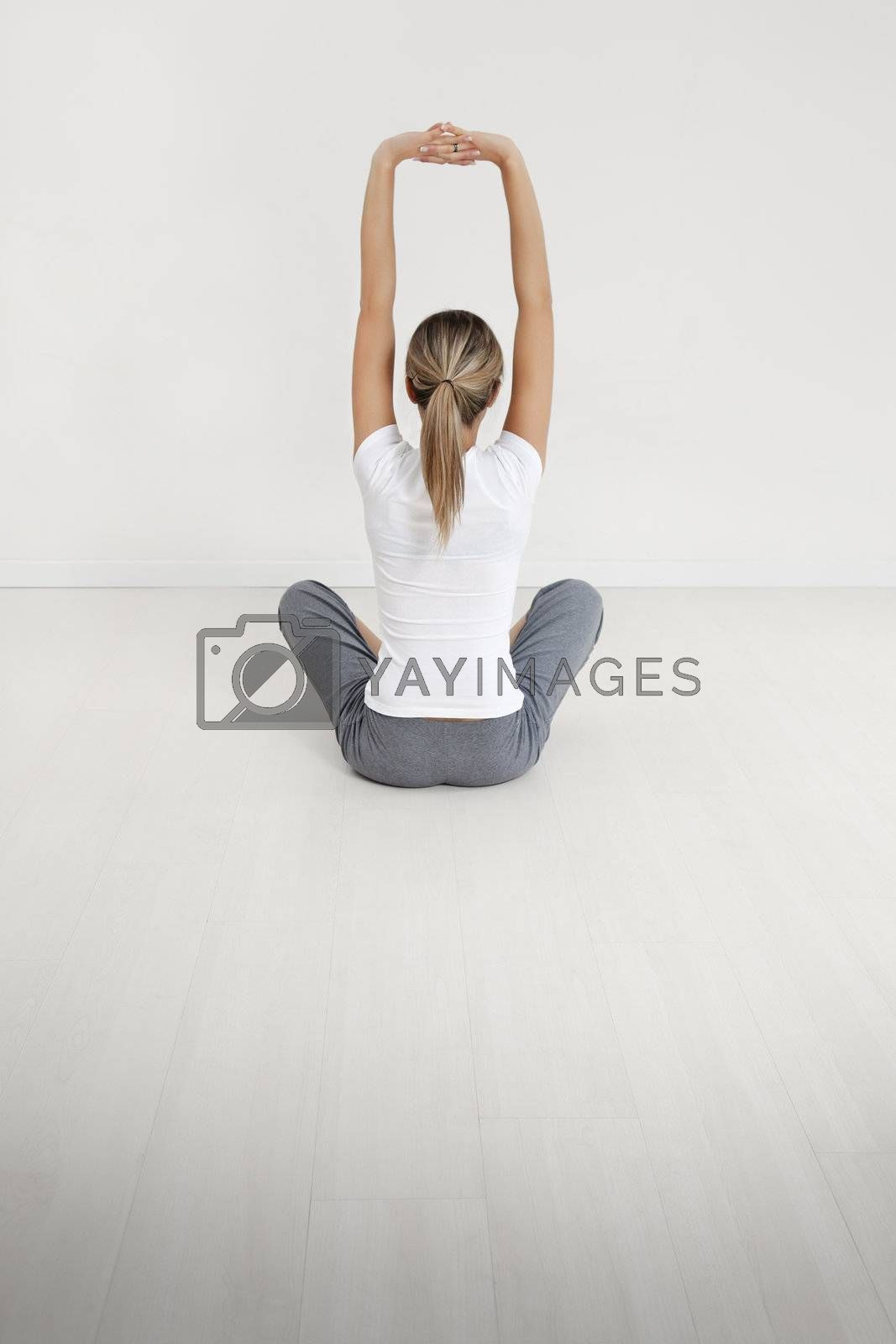 young woman doing yoga indoors. Copy space