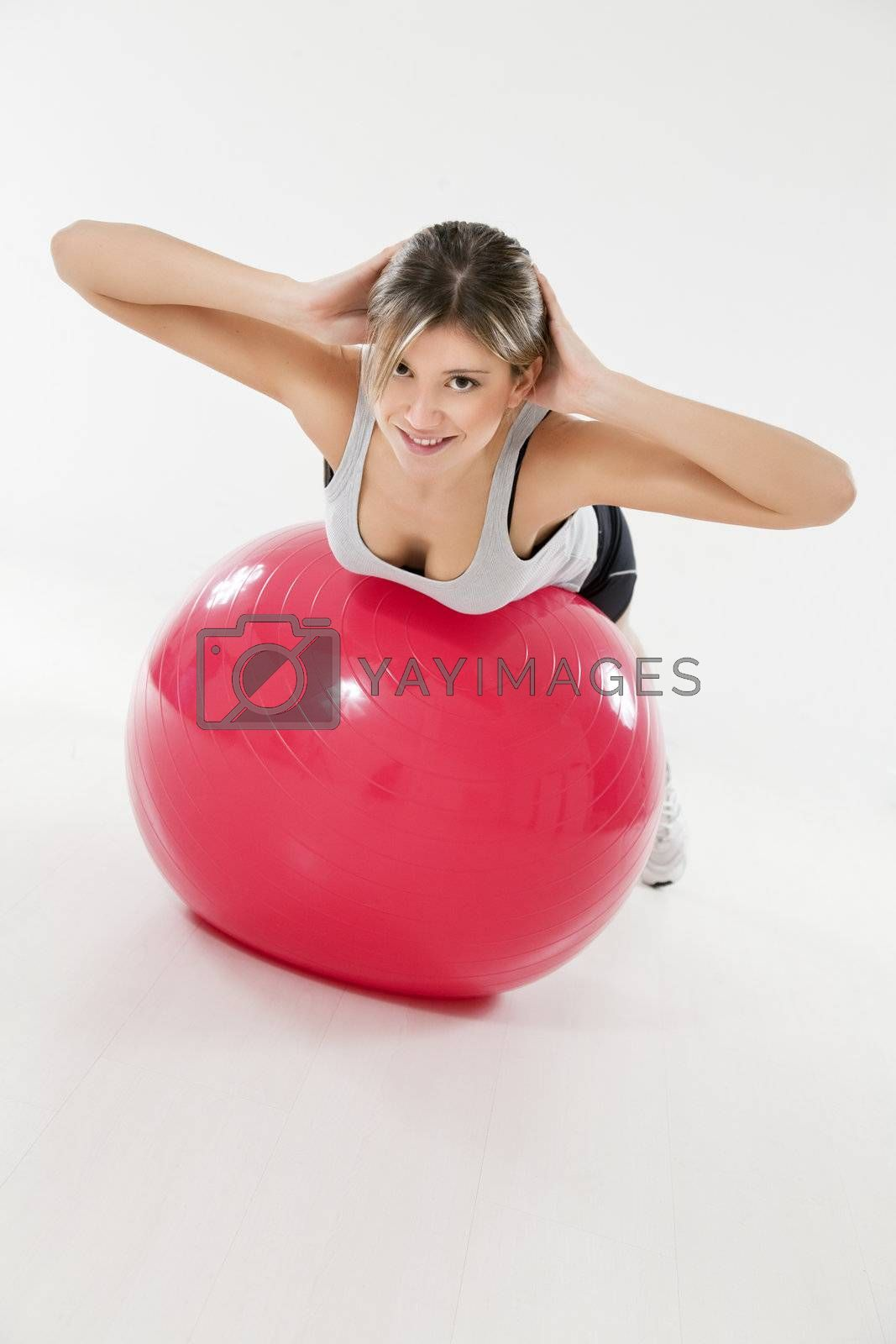 front view of woman exercising on fitness ball