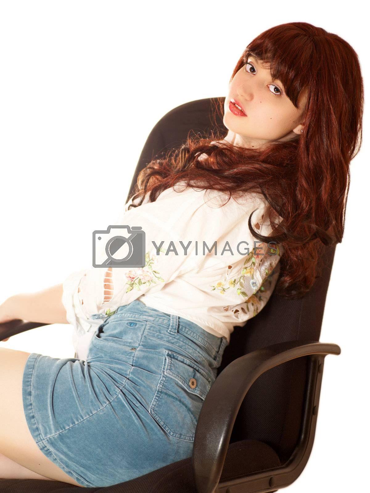 Young beautiful woman in armchair, isolated