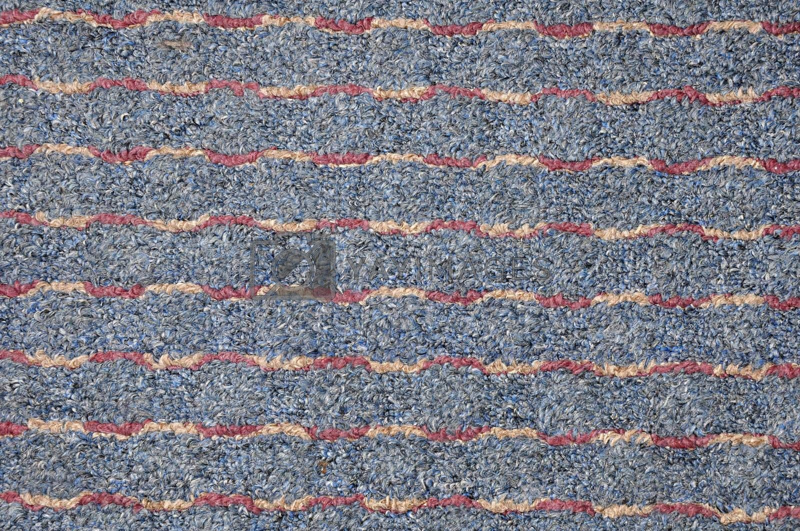 abstract view of a blue multi-colored carpet