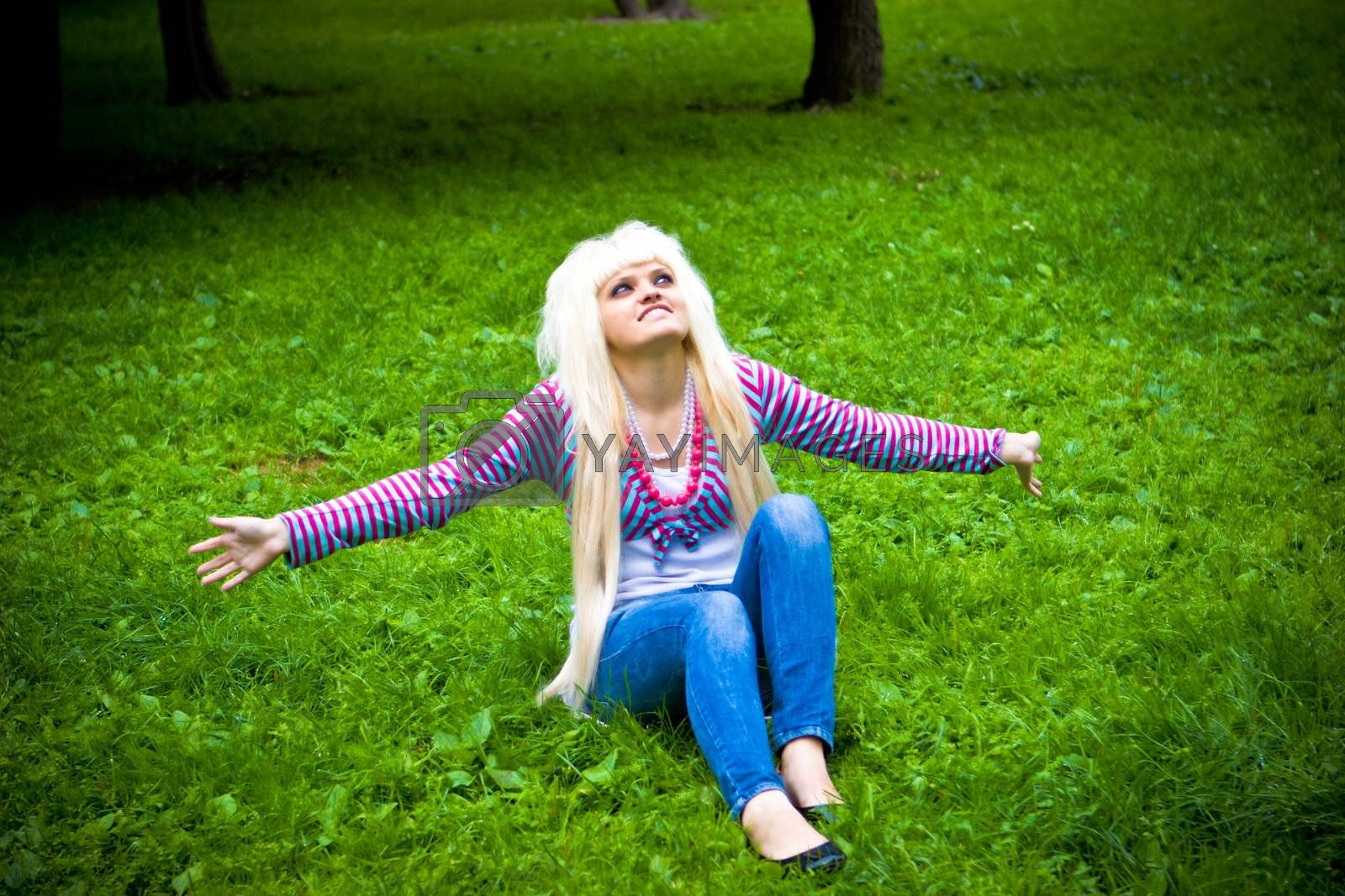 Happy young blond woman by olga_sweet