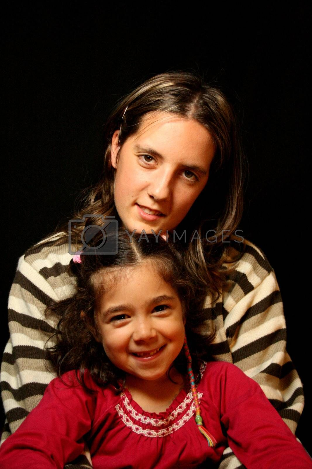 aunt and nephews over black background by jpcasais
